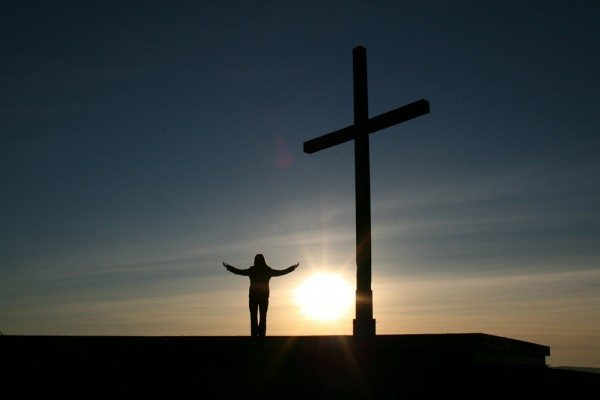 standing at the foot of the cross