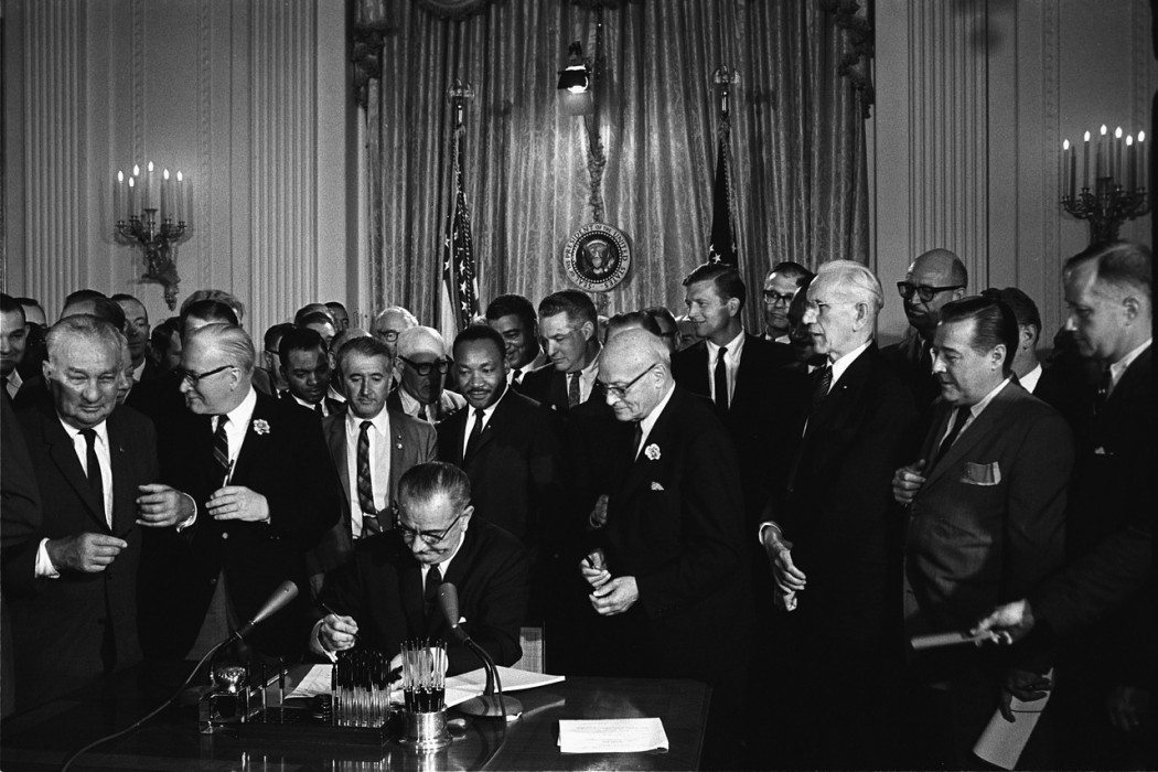 Johnson signing act, MLK